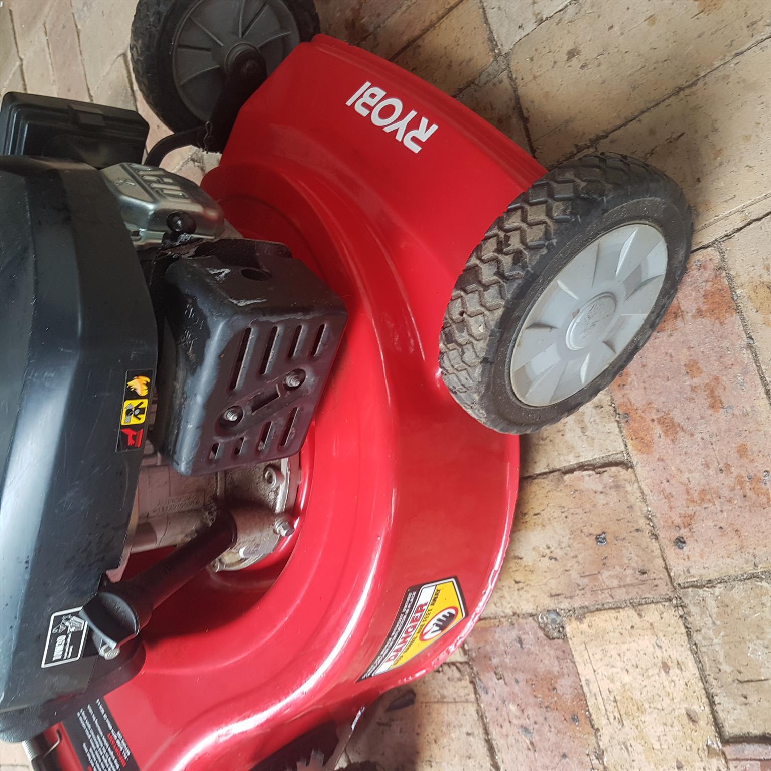 Ryobi Petrol grass machine