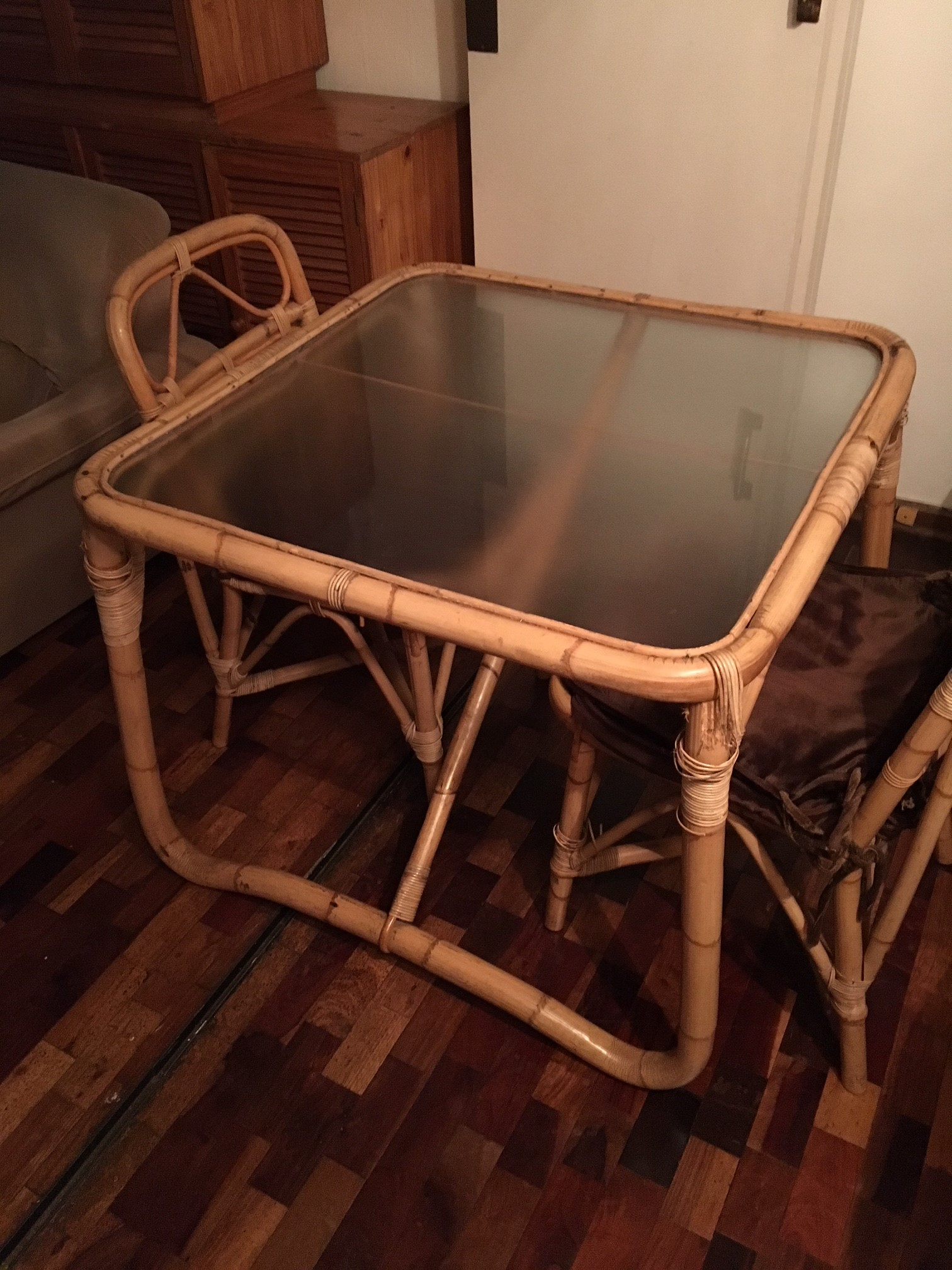 Cane table and 2 chairs for sale.
