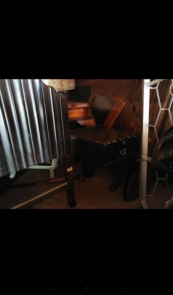 Dark wooden headboard with side drawer