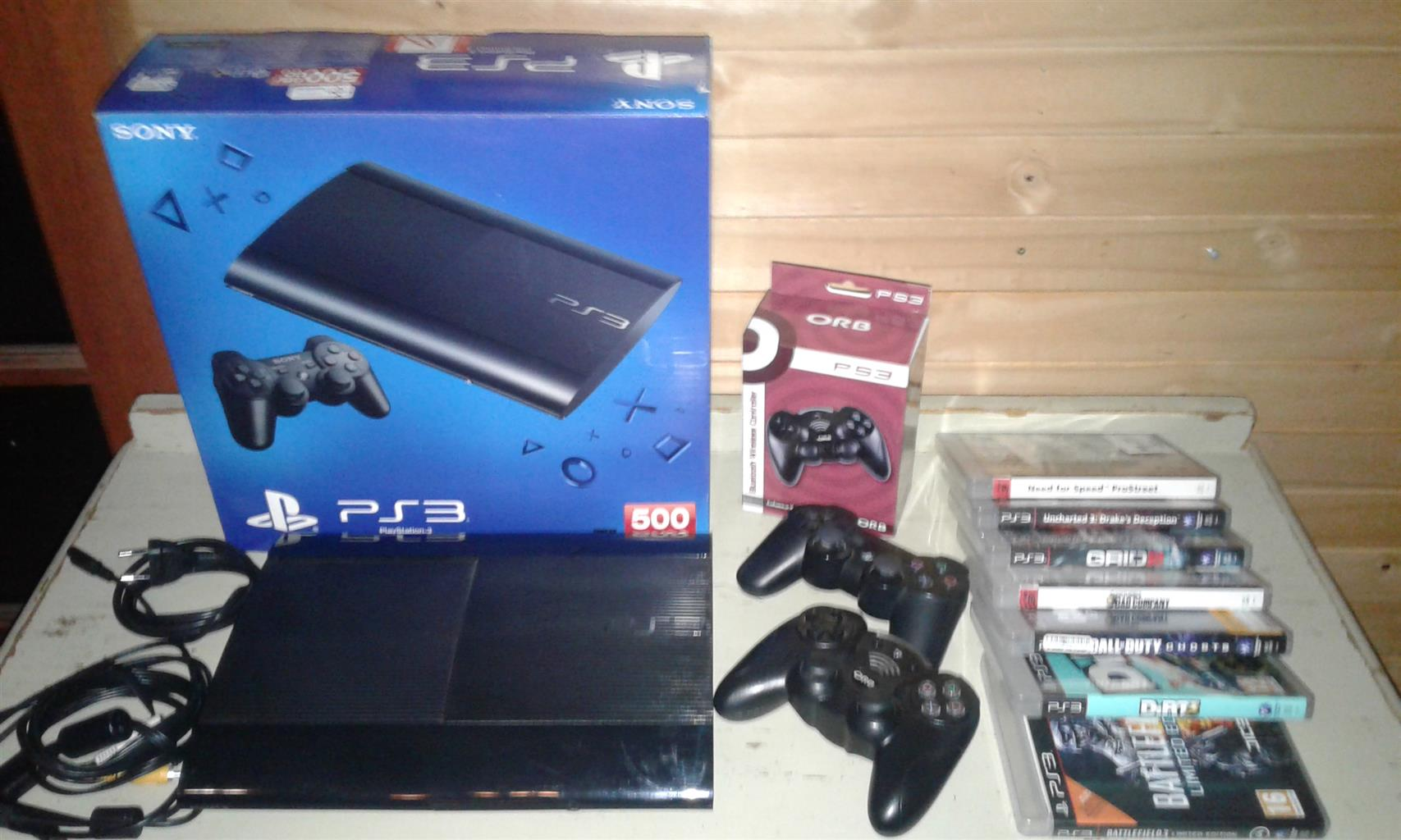 Ps3 with 2 remotes and 7games