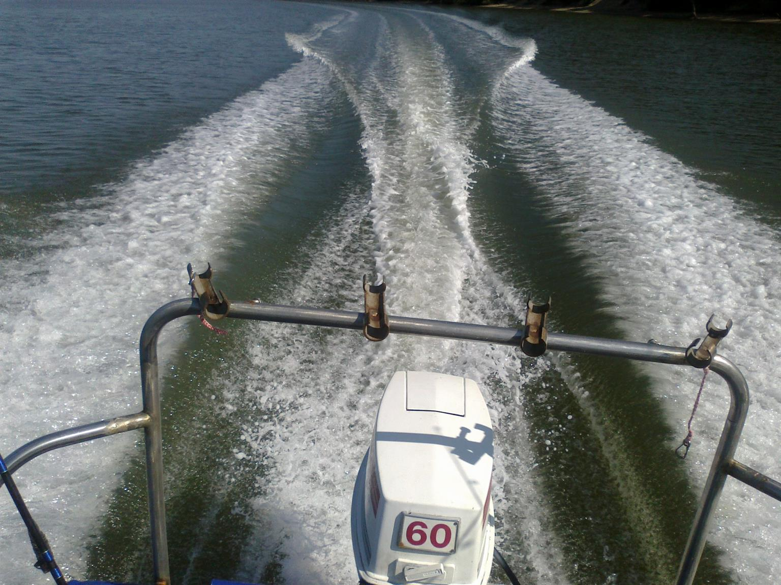 14vt6 skeevee boat with 60hp johnson enjine and galvenise trailor
