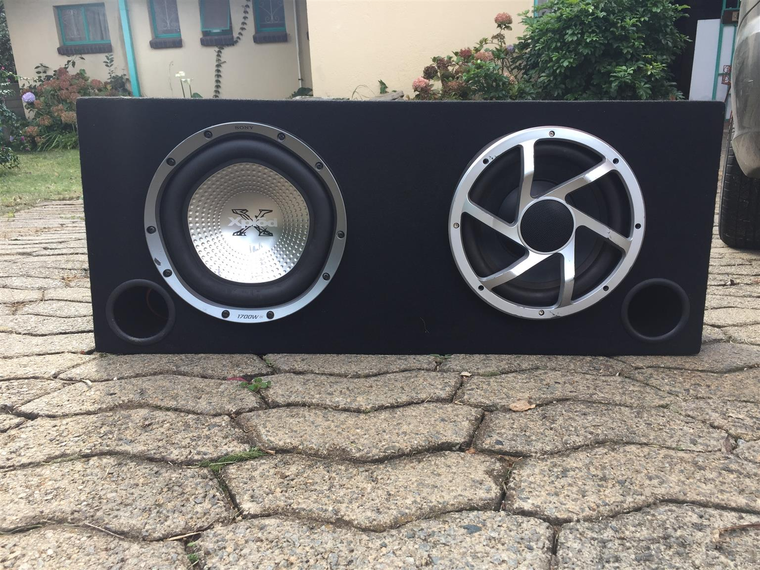 Two 10 inch subwoofers and 2000W 4 channel Amp