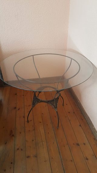 Round glass topped table