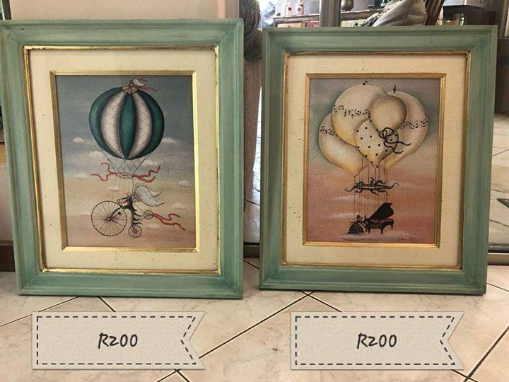 Green framed paintings