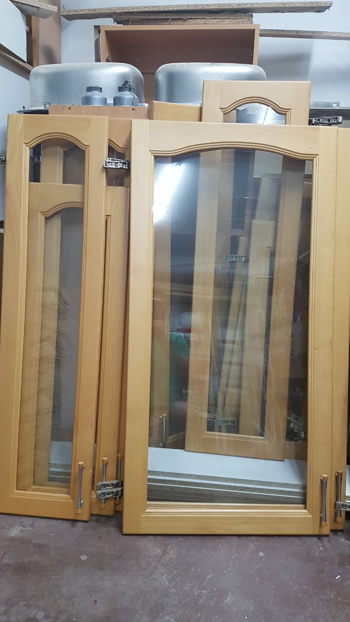 Fully intact wood and glass kitchen cupboards