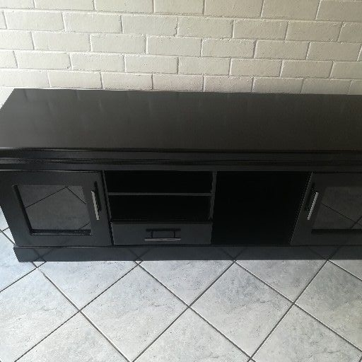 New black plasma TV stand with glass doors