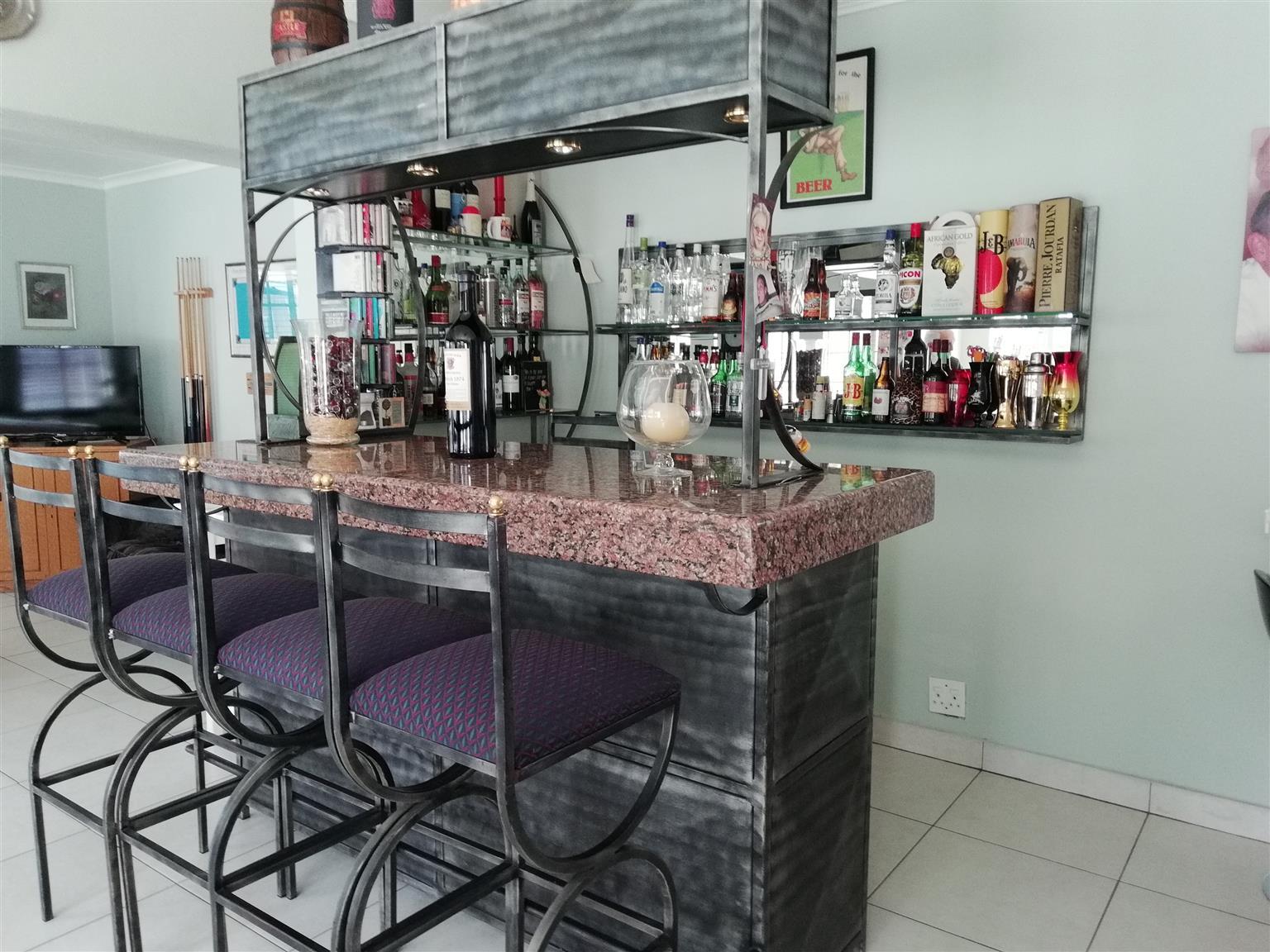 Large Bar consisting of Granite top & wrought Iron.