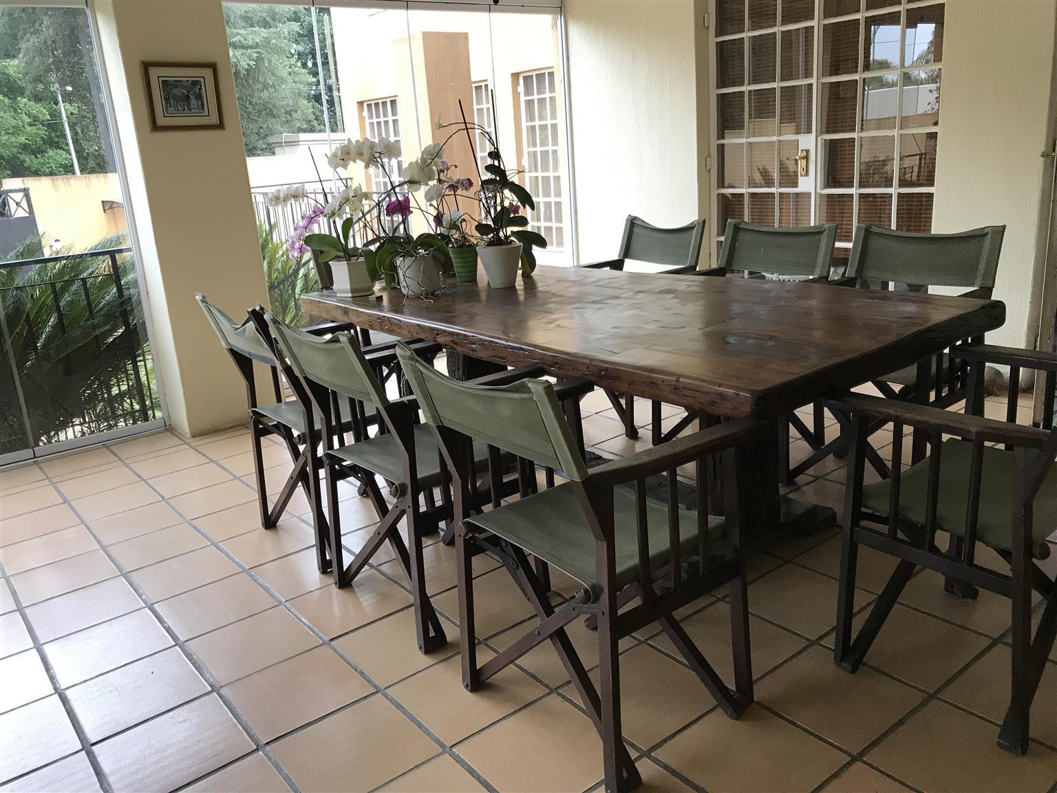 Solid 2,5 m sleeperwood dining room table plus 8 teak chairs