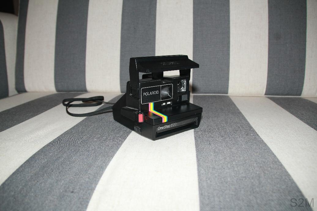 Polaroid OneStep 600 instant film camera.