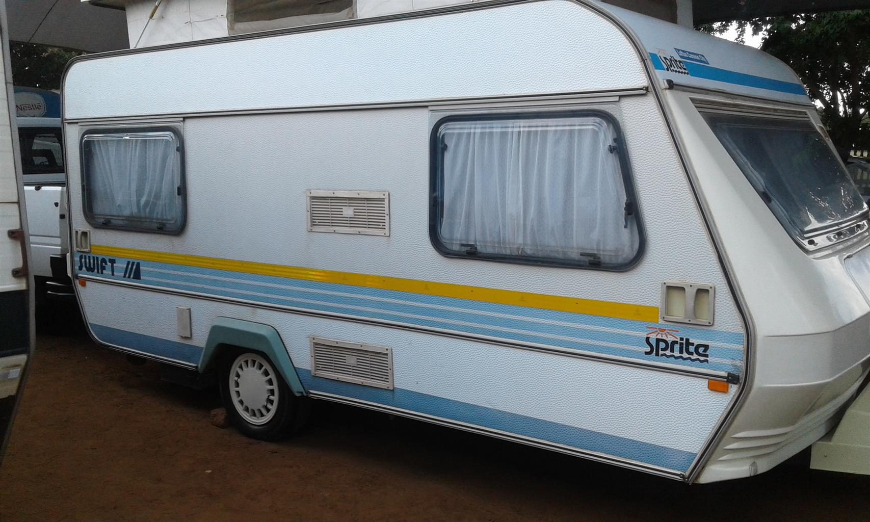 sprite swift with full tent and big fridge and freezer in excellent condition must be seen