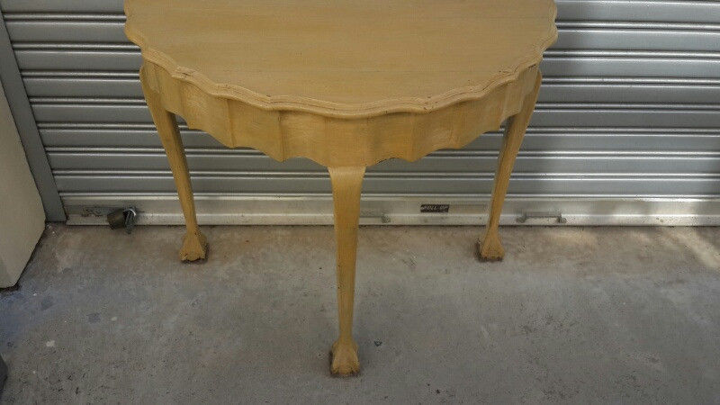 Half Moon Imboya hardwood table with all and claw legs