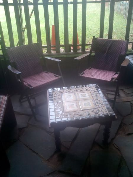 Mosaic table with purple chairs