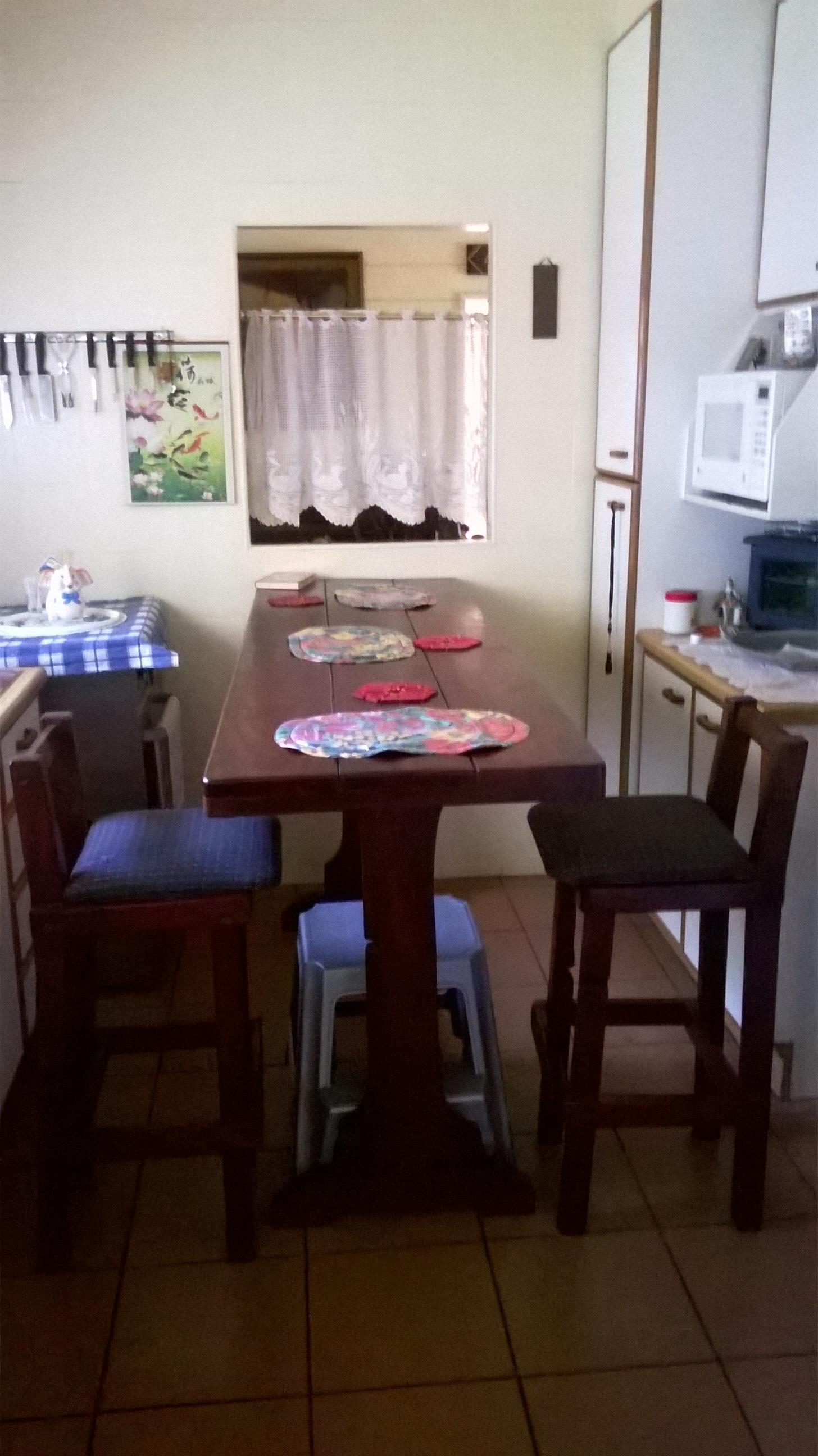 Mozambiqain Bar, with 6 matching bar stools
