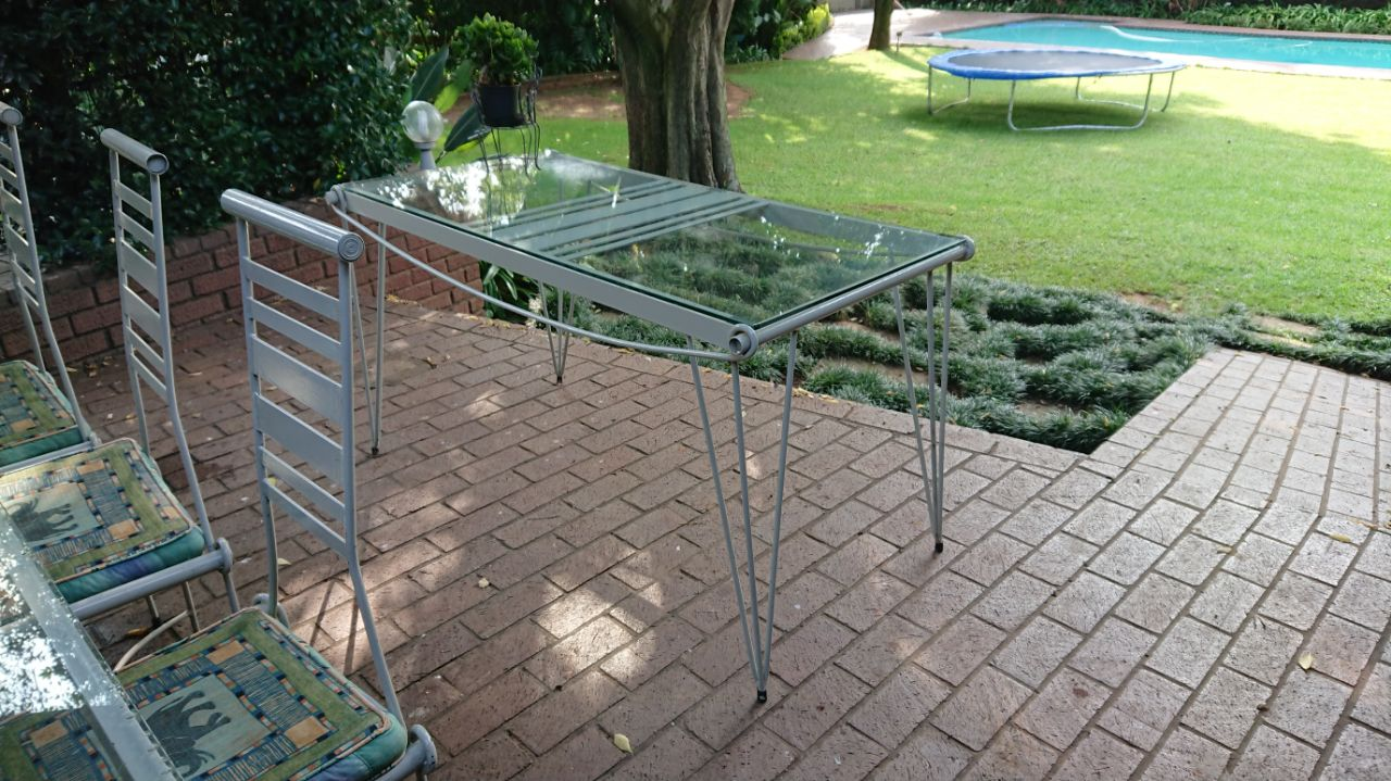 10 seater customer made wrought iron glass top table and sideboard
