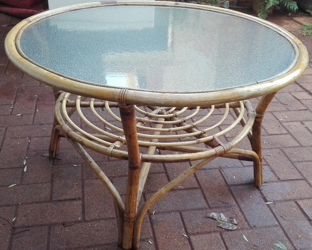 Cane coffee table with glass top