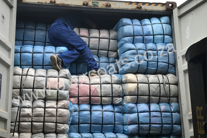 Second-hand coats and jackets in bales for resale. Buy a bale. Make your own cash.