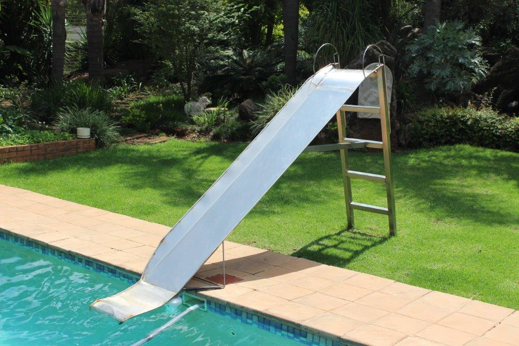 Stainless steel water slide with hosepipe connection for water fountain on the slide.