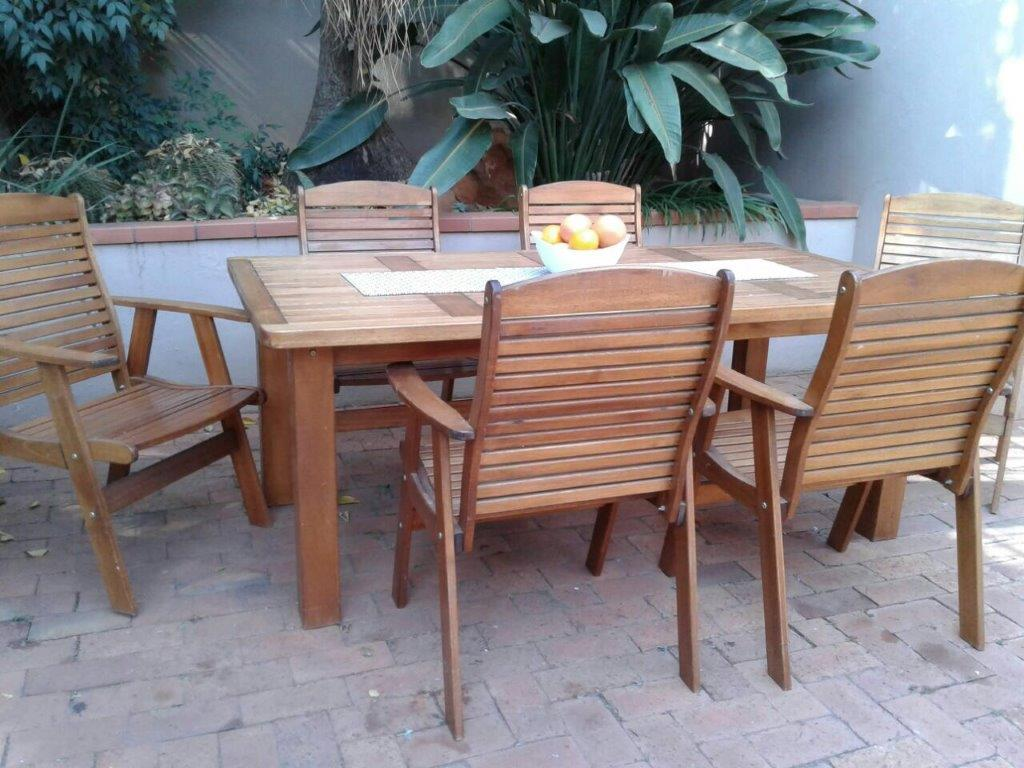 PATIO SET. SOLID MERANTI PATIO TABLE 1.8 x 1.1m with 6 x solid wood fold-up chairs