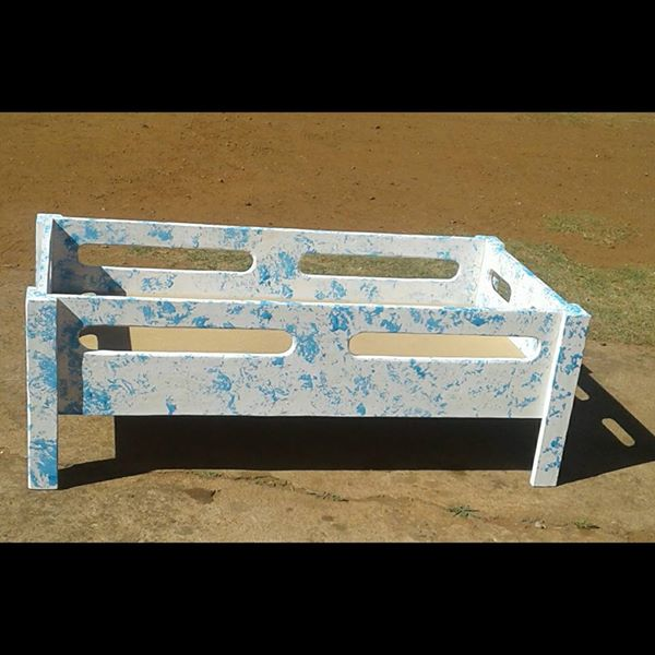 White and blue doll cot