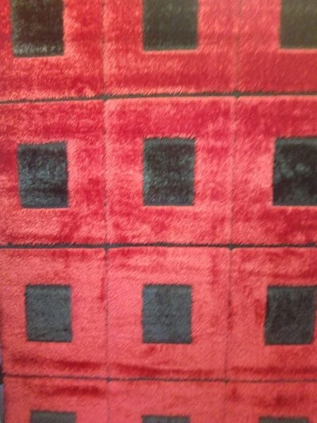 Red and black square pattern carpet