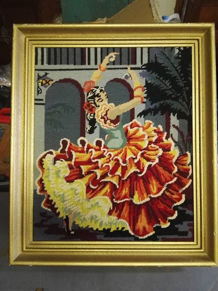Female dancer tapestry in frame