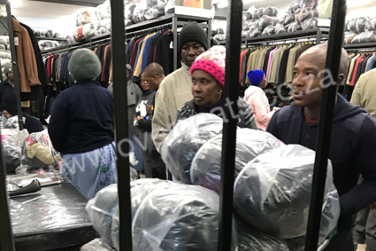 Second-hand coats and jackets in bales for resale