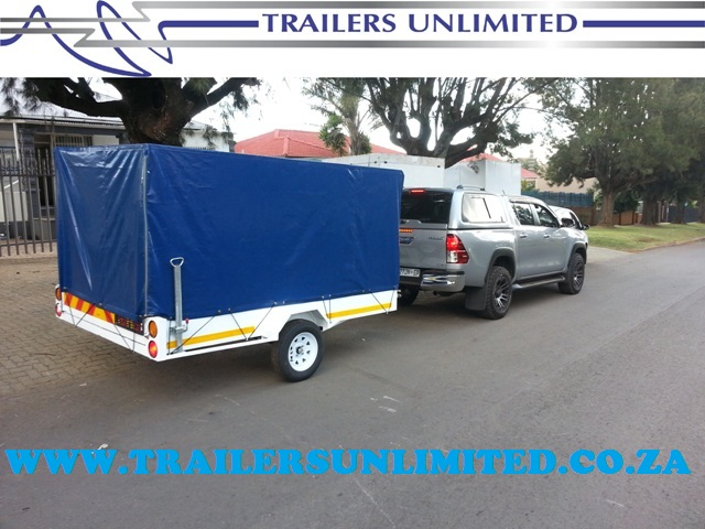 TRAILERS UNLIMITED UTILITY WITH PVC COVER.