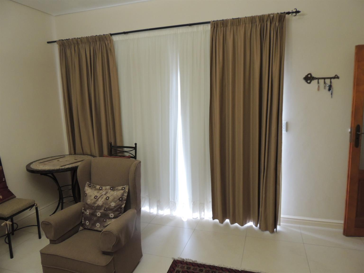 Beige curtains for sale.