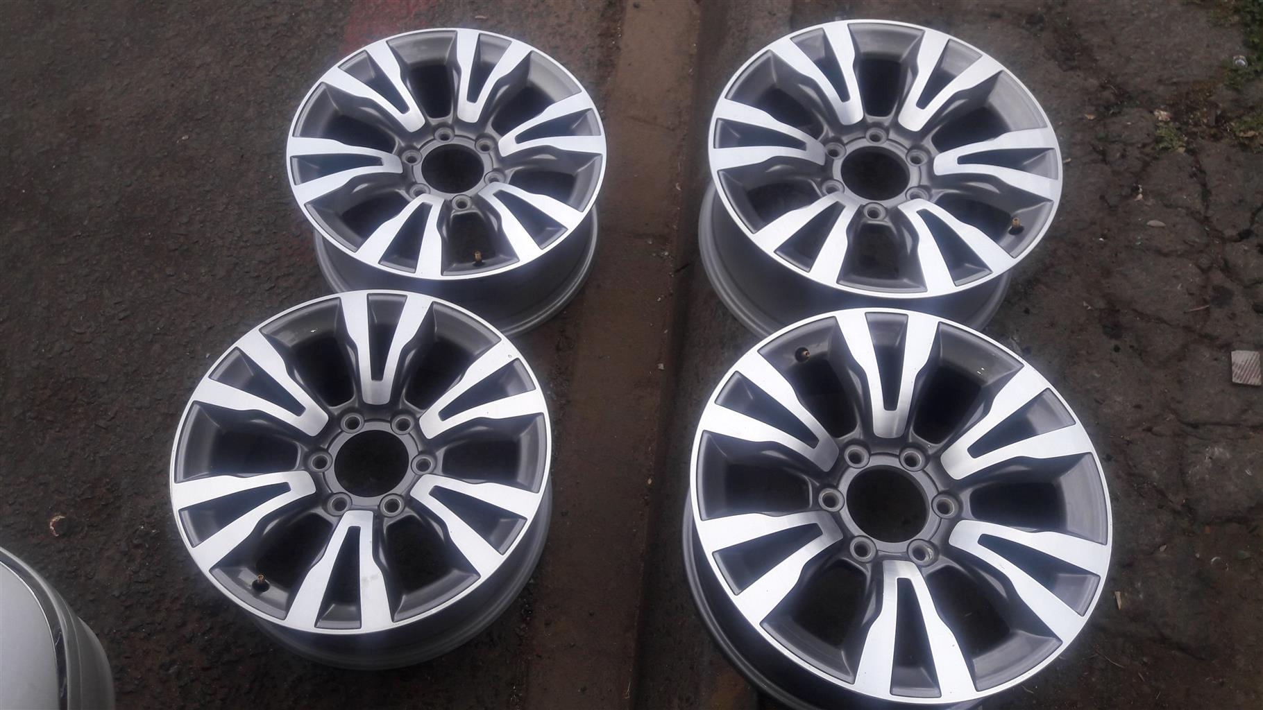 New 2016 18 inch  Izuzu silver and grey mags at very affordable prices still in perfect condition no dents and no scratches. prices include fitment.