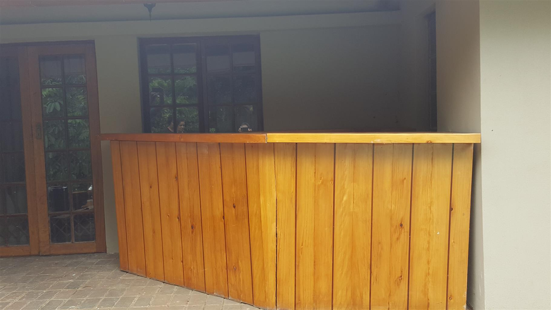 Wooden bar with shelving
