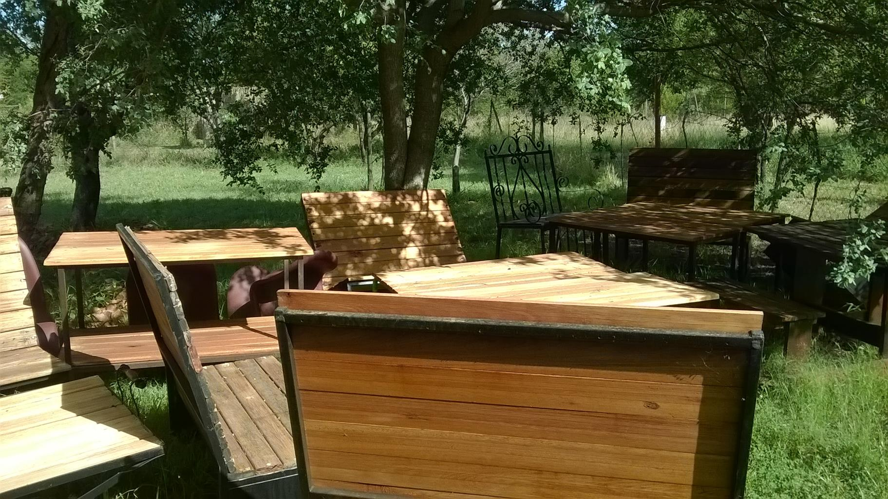 Wooden chairs and tables available