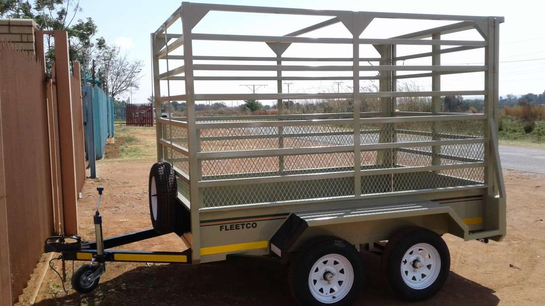 SMALL DOUBLE AXLE CATTLE TRAILER FOR SALE UNBRAKED, WITH SLIDING GATE AT THE BACK