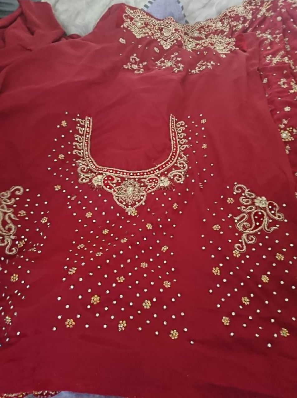 stunning red and gold wedding saree with blose piece