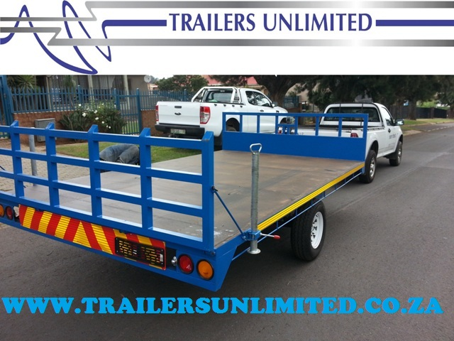 TRAILERS UNLIMITED BRAKE NECK FLAT BED TRAILER.