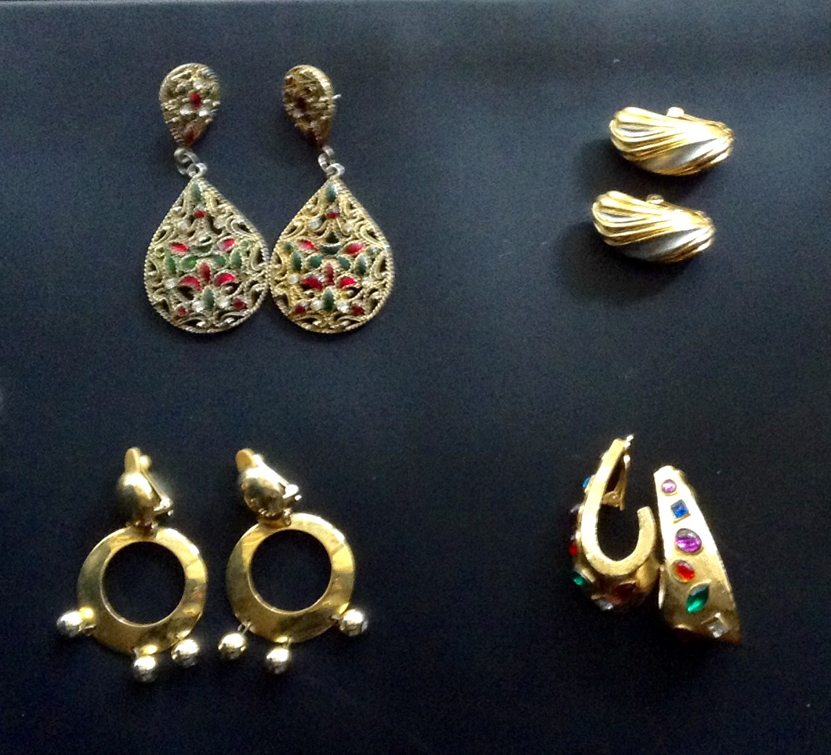 Set of four assorted earrings.  Plus get a FREE broach and earring set.