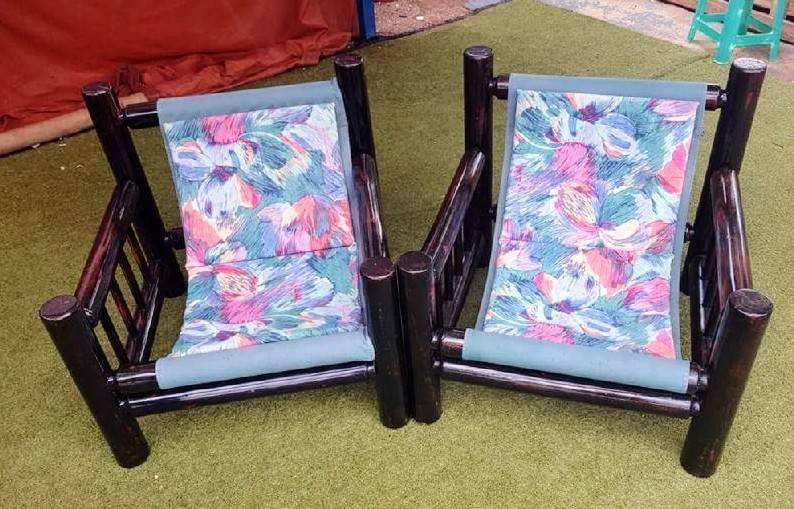 Dark wooden hammock chairs