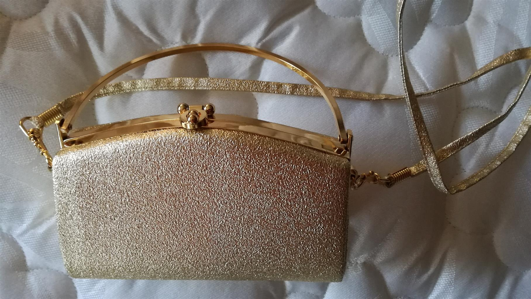 Golden metallic elegant evening handbag