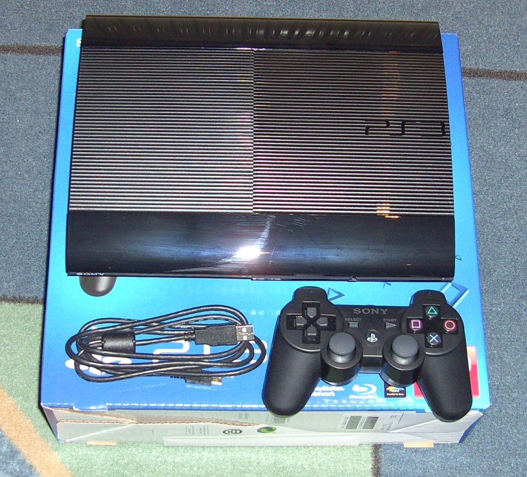 In Box Like New Playstation 3, 500GB Black Super Slimline, with 2 Latest Games, 2 Wireless Controllers & all Cables included...