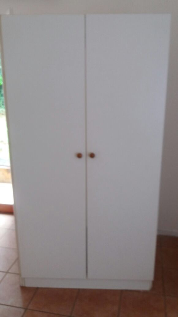 white melamine cupboard