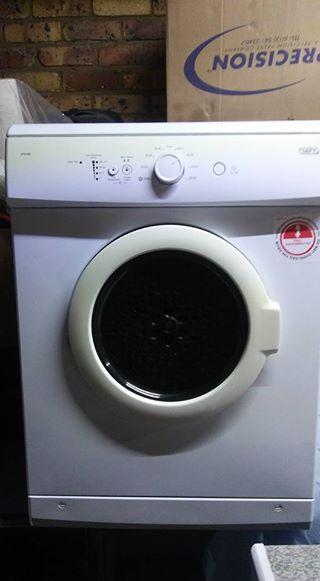 White Defy tumble dryers