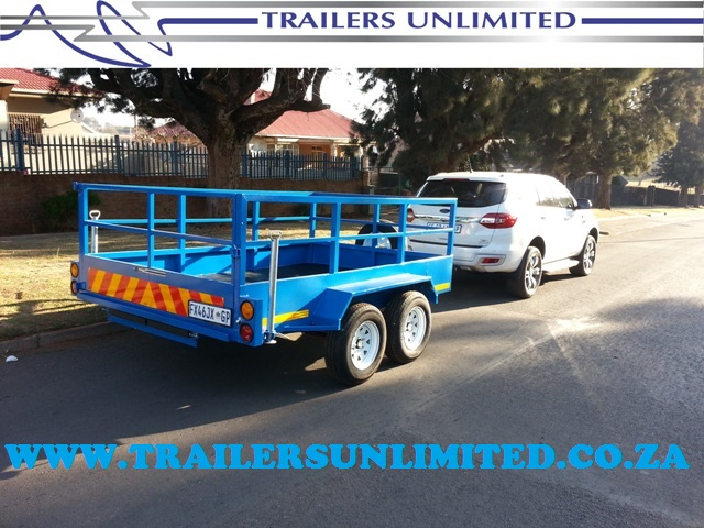 TRAILERS UNLIMITED DOUBLE AXLE UTILITY TRAILER.