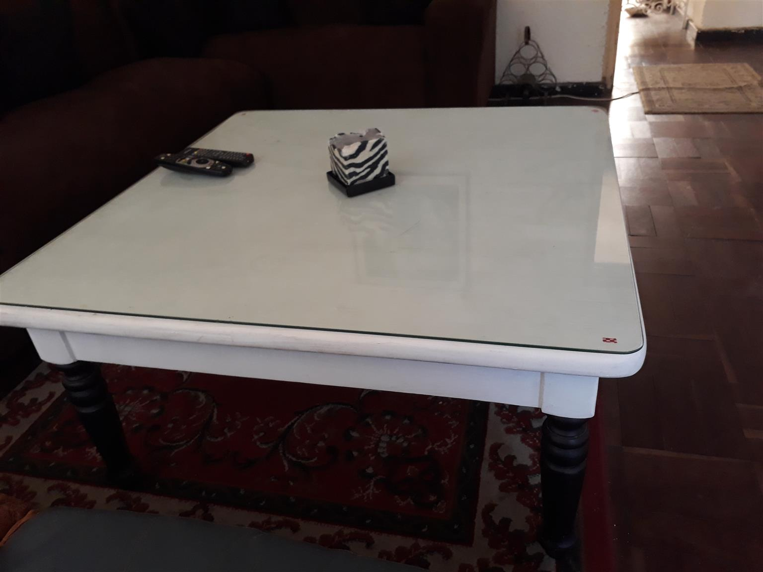 Wooden coffee table glass top