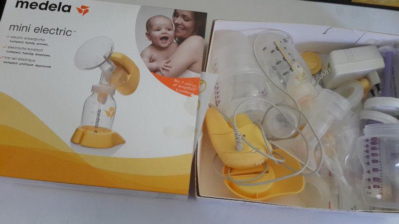 Medela Mini Electric breast pump complete and still in box