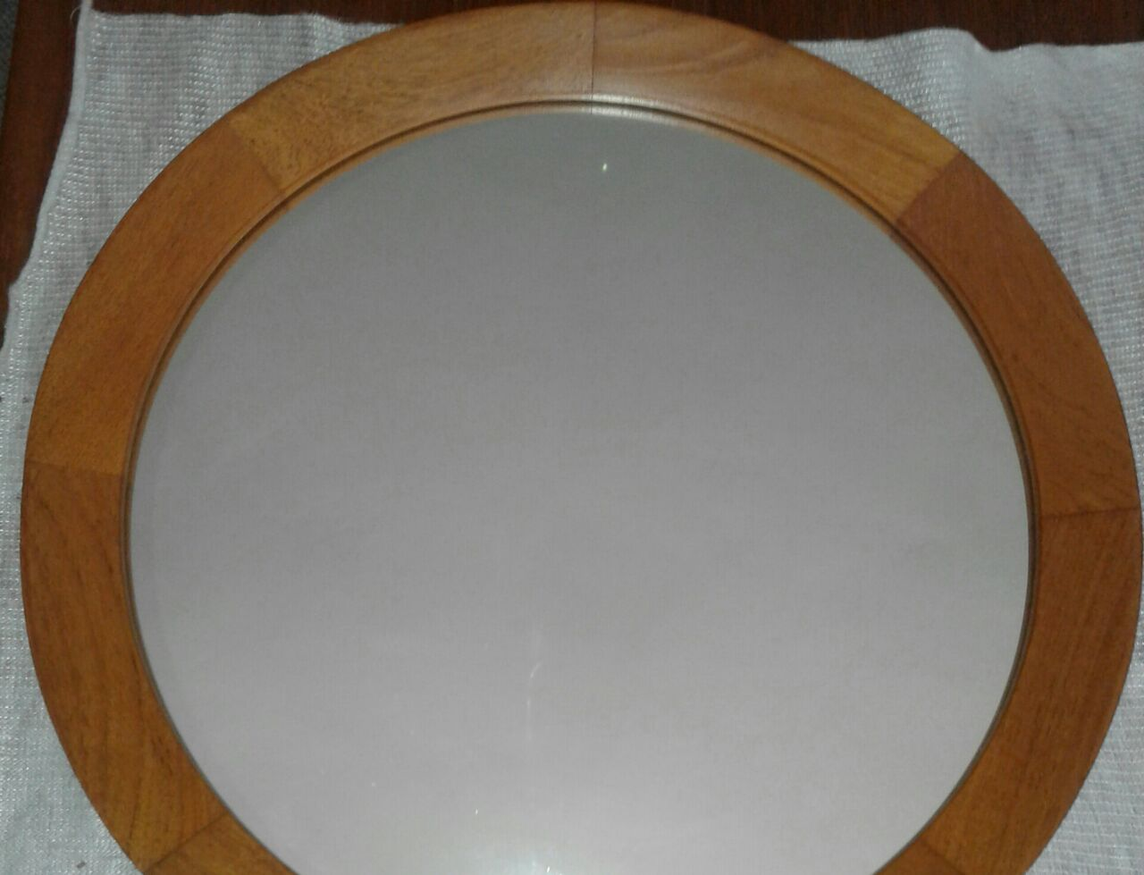 Mirror,round teak frame and back.Size 50cm