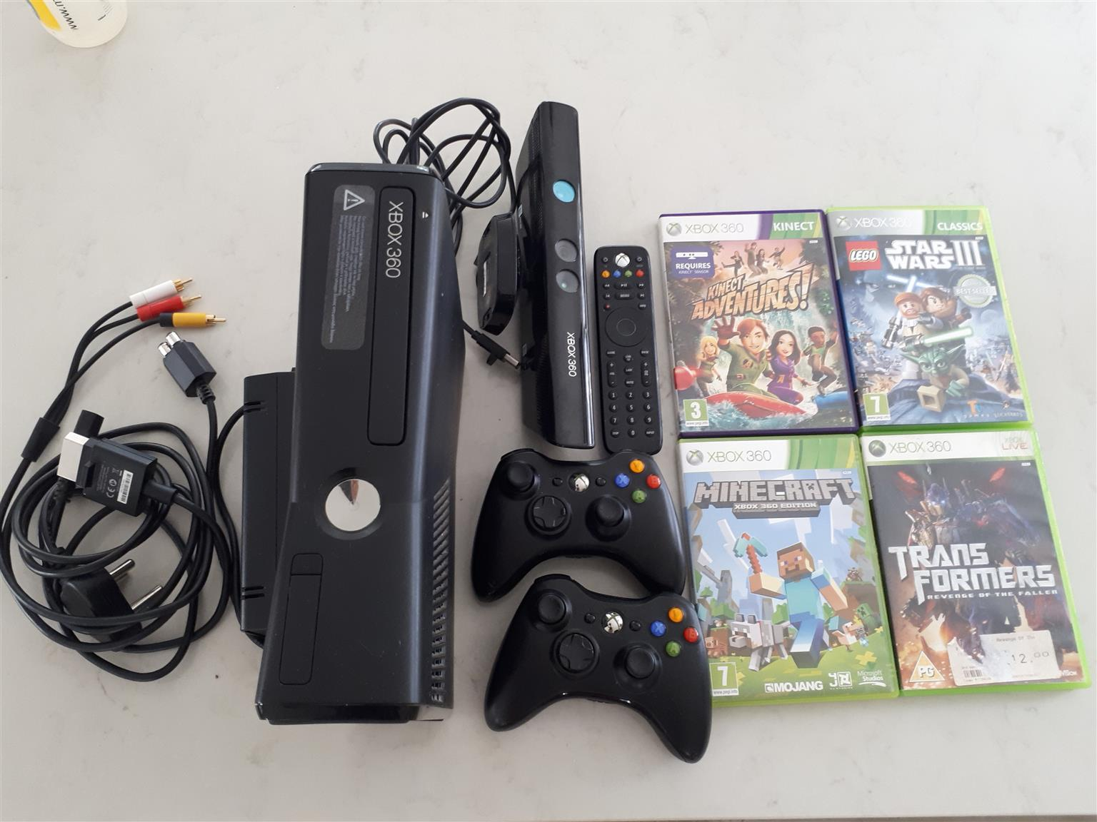 XBox 360 console, 2 wireless remote controllers + Kinect and 4 games