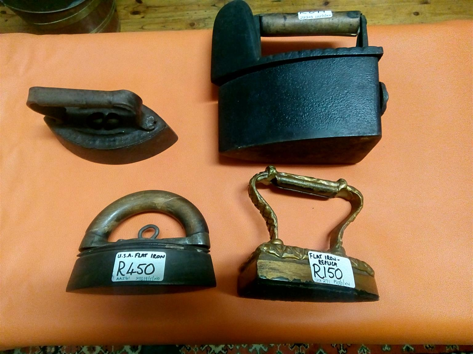 4 very rare and antique irons in different styles