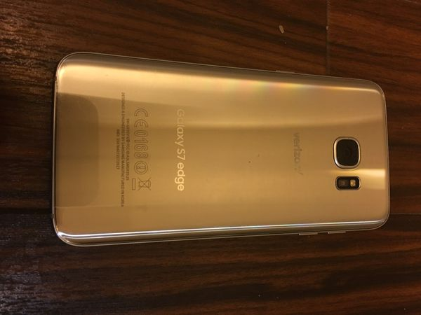 New Samsung gold S7 edge with Full Accessories