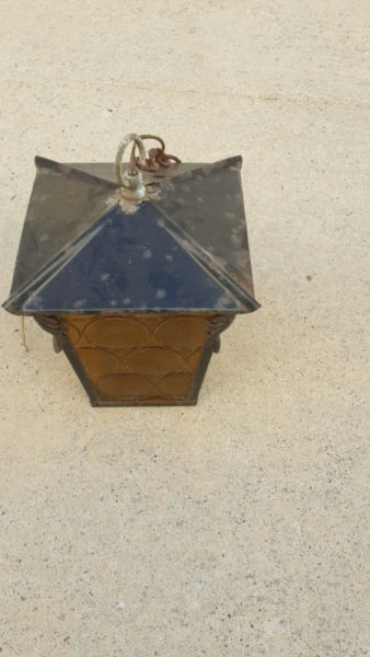 Lantern outside yellow and black