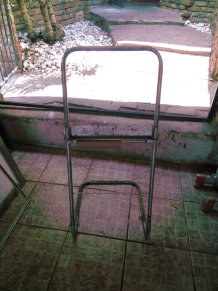 In great condition,  Industrial/ Commercial self-standing Solid Steel Garage Roll Holder for sale...
