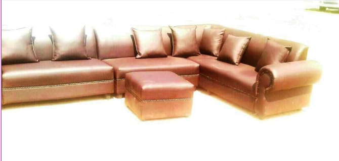 7 Seater leather couch, 7 cushions and 1 ottoman . 2 years warranty